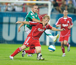 Grenchen, Switzerland - Tuesday, July 17, 2007: Liverpool's Dirk Kuyt in action against SV Werder Bremen's Leon Andreasen during a pre-season friendly at Stadion Bruhl. (Photo by David Rawcliffe/Propaganda)