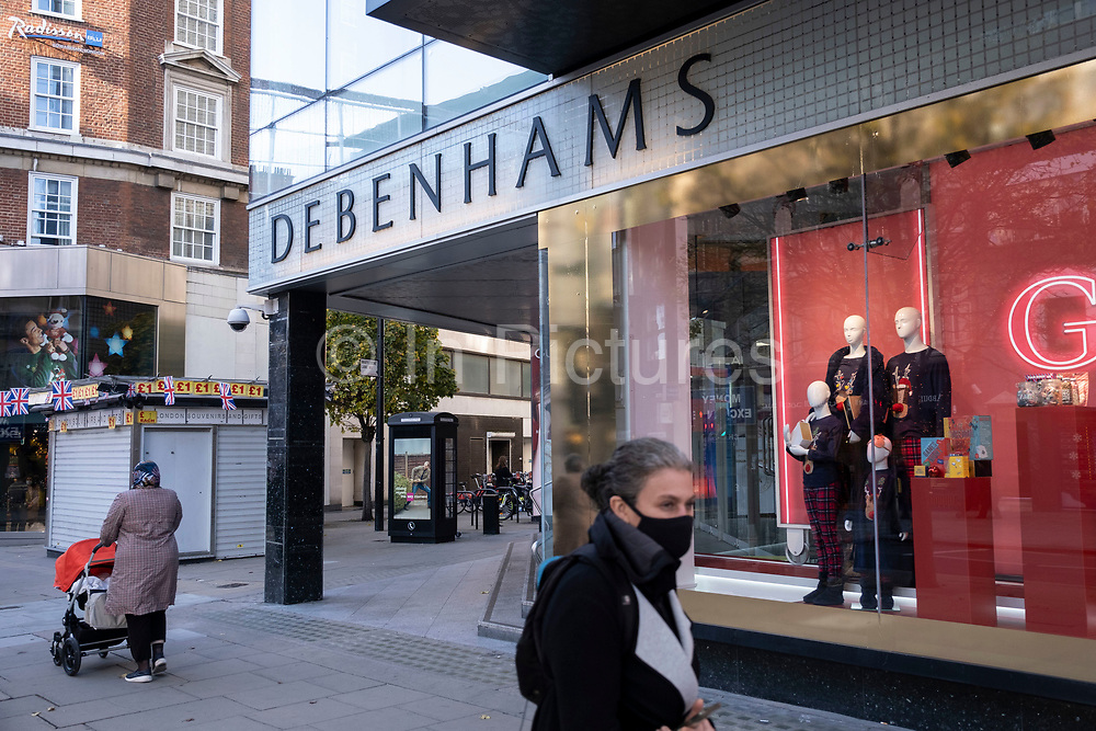 Peoplepass Debenhams flagship department store on Oxford Street as it is announced that talks to save the company have failed on 1st December 2020 in London, United Kingdom. Debenhams has been an ever present feature all over the UK for 242 years, but it has been announced that it will close all of its shops at the cost of around 12,000 jobs, and go into liquidation. This huge blow to the high street has not come as a surprise as the company has been struggling for some time.