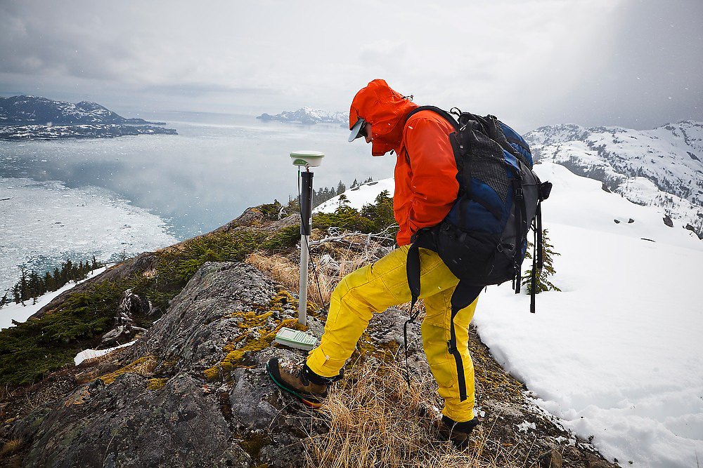 Ian Howat, glaciologist with Ohio State University, resurveys, with modern GPS, an old ground control point established by the USGS in an early study of the Columbia Glacier, near Valdez, Alaska. Resurveying will allow old and new data to be linked so as to precisely quantify, from the late 1970s to present, the dramatic retreat of the glacier.