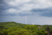 Lightning strikes a valley in Hue, Vietnam.  Sudden rain storms will flood urban streets and houses throughout the summer months.  Photo by Stan Olszewski/SOSKIphoto