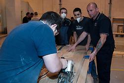 Prisoner in a woodwork workshop UK prison