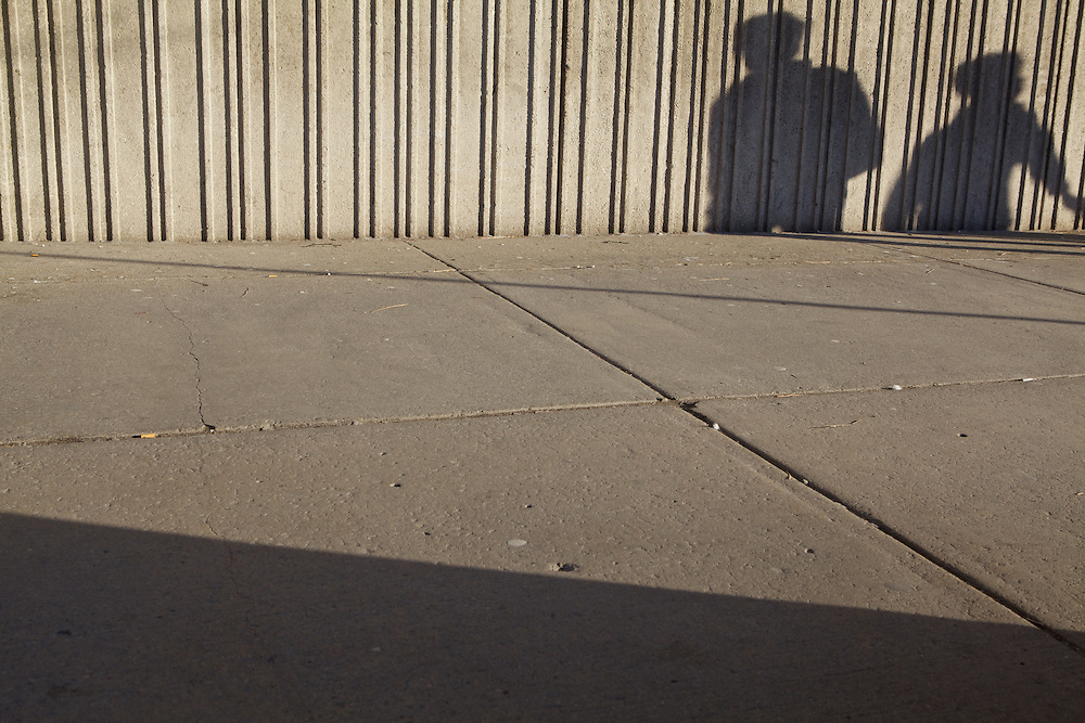 Long shadows as the sun sets in downtown Toronto.