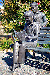 06 February 2015. Monroeville, Alabama.<br /> On the trail of Harper Lee's 'To Kill a Mocking Bird.'<br /> A statue of a girl reading at the Atticus Finch Memorial Park Monument outside the old courthouse whose courtroom was a model for the movie. The building is now the Monroe County Museum at the center of the old town. <br /> Photo; Charlie Varley/varleypix.com