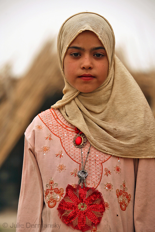 Marshland Arab girl in Maysan Province living in a staw hut with her family