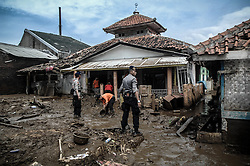 September 23, 2016 - Garut, Indonesia - K-9 Police with sniffer dogs search for missing victims on the Cimanuk river banks in Garut district, West Java province on September 23, 2016, a day after a series of landslides and flash floods hit several areas. The death toll from devastating floods and landslides in Indonesia has risen to 26, an official said, with hopes fading for 19 others still missing. (Credit Image: © Dasril Roszandi/NurPhoto via ZUMA Press)