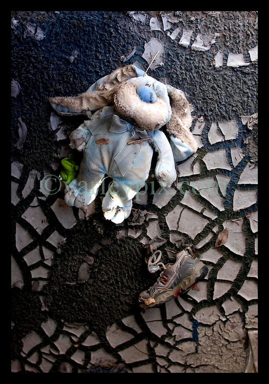 3rd November, 2005. A childs' toy and shoe lie inside a flood ravaged trailer at the Oak Grove trailer park in Saint Bernard parish just south of New Orleans. Hurricane Katrina caused a 20ft tidal surge to sweep over the land, devastating much of the parish.