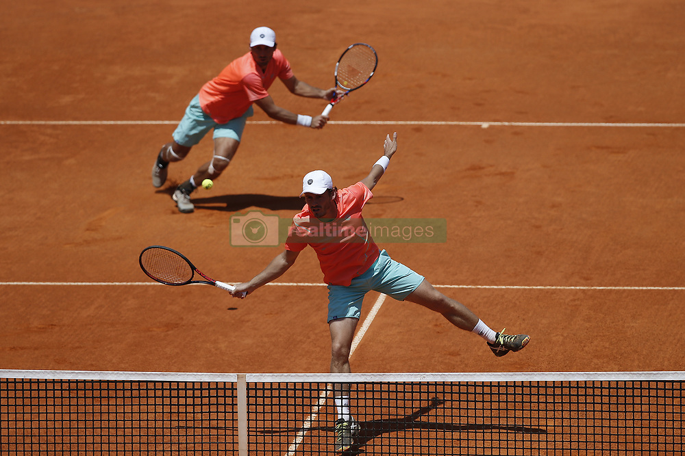 May 6, 2018 - Estoril, Portugal - Wesley Koolhof from Netherlands (R)  returns a shot against Artem Sitak from New Zealand (L) and Cameron Norrie from Great Britain while playing with Artem Sitak from New Zealand during the Millennium Estoril Open ATP doubles final tennis match in Estoril, near Lisbon, on May 6, 2018. (Credit Image: © Carlos Palma/NurPhoto via ZUMA Press)