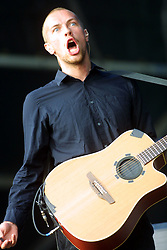 Coldplay singer Chris Martin plays the main stage at T in the Park 8th July 2001.