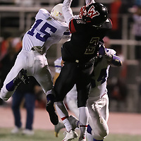 (Photograph by Bill Gerth for SVCN)  Westmont #2 Ethan Go goes high to make the catch to set up Westmont's  first touchdown vs Soledad in the  CCS Division 4 Championship Football Game at Independence High School, San Jose CA on 11/26/16.  (Westmont 13  Soledad 17)