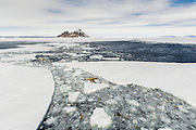 Broken sea ice and ice algae off the stern of a Russian icebreaker with Cockburn Island on the horizon, Admiralty Sound, Weddell Sea, Antarctic Peninsula