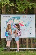 Henham Park, Suffolk, 19 July 2019. Checking the map - The 2019 Latitude Festival.