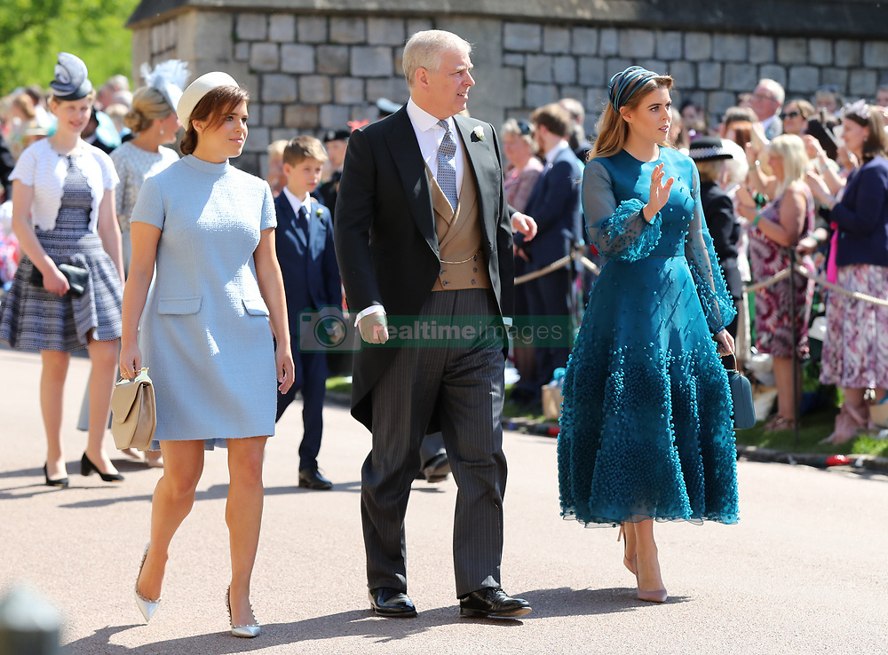 (left to right) Princess Eugenie, The Duke of York and Princess Beatrice arrive at St George's Chapel at Windsor Castle for the wedding of Meghan Markle and Prince Harry.