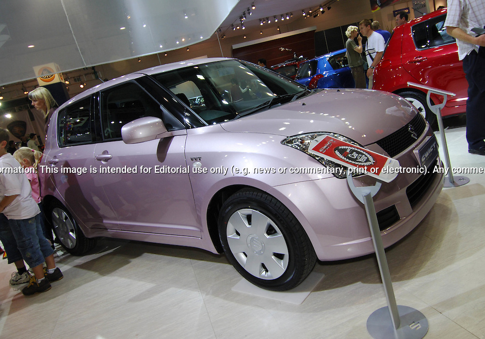 2006 Suzuki Swift - Limited Edition Pink.Melbourne International Motorshow, .Melbourne Exhibition Centre. Clarendon St, Southbank, Melbourne .14th February 2006.(C) Joel Strickland Photographics.Use information: This image is intended for Editorial use only (e.g. news or commentary, print or electronic). Any commercial or promotional use requires additional clearance.