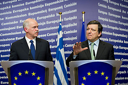 """George Papandreou, Greece's prime minister, left, listens as Jose Manuel Barroso, president of the European Commission, speaks, during a press briefing following their meeting at the European Union Commission headquarters in Brussels, Belgium, on Wednesday, March 17, 2010. German Chancellor Angela Merkel said the European Union must avoid any """"overly hasty"""" aid pledge to Greece. (Photo © Jock Fistick)"""