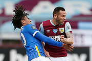 Brighton and Hove Albion defender Bernardo Fernandes da Silva Junior (30) feels a challenge form Phillip Bardsley of Burnley (26)  during the Premier League match between Burnley and Brighton and Hove Albion at Turf Moor, Burnley, England on 26 July 2020.