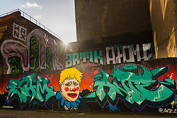© Licensed to London News Pictures. 11/02/2020. London, UK. General street view of graffiti depicting Prime minister Boris Johnson as a clown, near Brick Lane in London. Photo credit: Vickie Flores/LNP