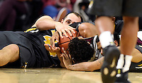 Texas A&M's Admon Gilder (3) tries to call time out while fighting for a loose with Missouri's Ryan Rosburg (44) and Jakeenan Gant (23) during the second half of an NCAA college basketball game, Saturday, Jan. 23, 2016, in College Station, Texas.  Texas A&M won 66-53.  (AP Photo/Sam Craft)