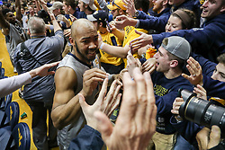 Feb 26, 2018; Morgantown, WV, USA; West Virginia Mountaineers guard Jevon Carter (2) celebrates with students after beating the Texas Tech Red Raiders at WVU Coliseum. Mandatory Credit: Ben Queen-USA TODAY Sports