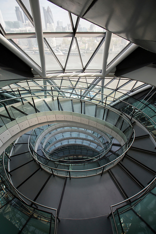 The staircase and central atrium of City Hall, home of the GLA. RE:FIT London is a Greater London Authority (GLA) program to make London's non-domestic public buildings more energy efficient. London, UK. © Andrew Aitchison / Ashden