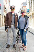 food shopping couple using eye cover sleeping mask and winter gloves for protection during Covid 19 crisis and lockdown France Limoux April 2020