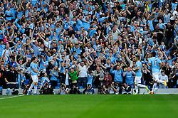 Manchester City's Samir Nasri celebrates his goal. - Photo mandatory by-line: Dougie Allward/JMP - Tel: Mobile: 07966 386802 22/09/2013 - SPORT - FOOTBALL - City of Manchester Stadium - Manchester - Manchester City V Manchester United - Barclays Premier League