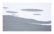 abstract pattern of snow on frozen lake after first snowfall of season