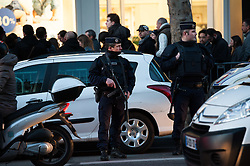 "© London News Pictures. 16/02/2015 Olympia Theatre, Paris: A heavy police precedes as the Eagles of Death Metal ""resume their gig"" three months after the terrorist attack at Bataclan that claimed the lives of 90 people on 13 November 2015. Heavy security was in evidence and media kept at a distance ""to preserve the dignity of returning survivors"" according to a police spokesperson. Ticket holders of the fateful Bataclan concert were offered complimentary tickets for tonight's gig. Photo credit: Guilhem Baker/LNP"