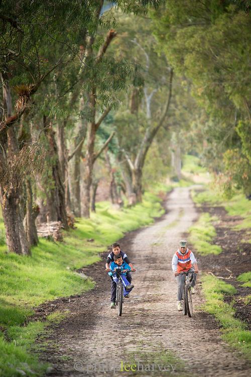 Children riding bicycles , Ecuador, South America