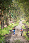 Children riding bicycles , Ecuador, South America