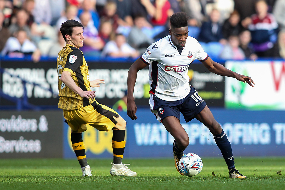 Bolton Wanderers'  Sammy Ameobi competing with Sheffield Wednesday's Kieran Lee<br /> <br /> Photographer Andrew Kearns/CameraSport<br /> <br /> The EFL Sky Bet Championship - Bolton Wanderers v Sheffield Wednesday - Saturday 14th October 2017 - Macron Stadium - Bolton<br /> <br /> World Copyright © 2017 CameraSport. All rights reserved. 43 Linden Ave. Countesthorpe. Leicester. England. LE8 5PG - Tel: +44 (0) 116 277 4147 - admin@camerasport.com - www.camerasport.com