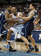 DENVER, CO - APRIL 17 : Chauncey Billups #1 of the Denver Nuggets tries to split the defense of Paul Millsap #24 and Deron Williams #8 of the Utah Jazz during the first half of Game One of the Western Conference Quarterfinals of the 2010 NBA Playoffs at the Pepsi Center on April 17, 2010 in Denver, Colorado. (Photo by Marc Piscotty/ © 2010)