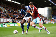 Clayton Donaldson of Birmingham City holds off Michael Keane of Burnley. Skybet football league championship match, Burnley  v Birmingham City at Turf Moor in Burnley, Lancs on Saturday 15th August 2015.<br /> pic by Chris Stading, Andrew Orchard sports photography.