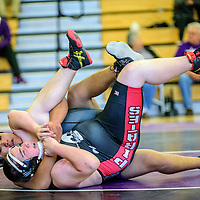 Miyamura Patriot Marcus James wrestles with Grants Pirate Casey Gordon at Miyamura High School Saturday.