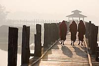 "Monks taking an early morning stroll on the teak wood U-Bein Bridge, Amarapura, Myanmar.<br /> Available as Fine Art Print in the following sizes:<br /> 08""x12""US$   100.00<br /> 10""x15""US$ 150.00<br /> 12""x18""US$ 200.00<br /> 16""x24""US$ 300.00<br /> 20""x30""US$ 500.00"