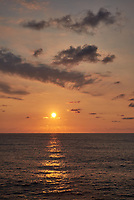Orange colored sky and clouds over the Pacific Ocean just after sunrise. Image 7 of 10 for a wide-angle panorama taken with a Fuji X-T1 camera and 35 mm f/1.4 lens  (ISO 200, 35 mm, f/16, 1/250 sec). Raw images processed with Capture One Pro and stitched together with AutoPano Giga Pro.