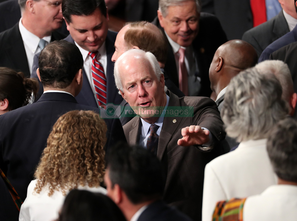 United States Senator John Cornyn (Republican of Texas) waves to a colleague prior to US President Donald J. Trump delivers his second annual State of the Union Address to a joint session of the US Congress in the US Capitol in Washington, DC, USA on Tuesday, February 5, 2019. Photo by Alex Edelman/CNP/ABACAPRESS.COM