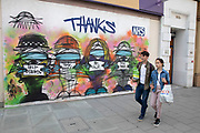 Thanks to the NHS graffiti as the Coronavirus lockdown measures are set to ease further, the west end starts to fill with people as they return to the shopping district on Oxford Street and the quiet city starts coming to an end on 22nd June 2020 in London, England, United Kingdom. As of today the government has relaxed its lockdown rules, and is allowing some non-essential shops to open with individual shops setting up social distancing queueing systems.