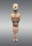 Cycladic Canonical type, Spedos variety female figurine statuette. Early Cycladic Period II, (2800-2300 BC), 'Steiner Master'.  Museum of Cycladic Art Athens, cat no 654.  Against Grey Background.