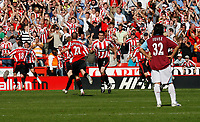 Photo: Paul Greenwood.<br />Sheffield United v West Ham United. The Barclays Premiership. 14/04/2007.<br />West Ham's Carlos Tevez stands and watches Sheffield United celebrate