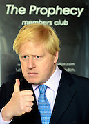 """© Licensed to London News Pictures. 14/05/2013. London, UK Boris Johnson stands near a poster in Wimbledon Station for """"The Prophecy"""" members club. The Mayor of London, Boris Johnson, leads a short walkabout around Wimbledon High Street to meet local people as he helps launch a public consultation on proposed routes for Crossrail 2. Today 14th May 2013. Photo credit : Stephen Simpson/LNP"""