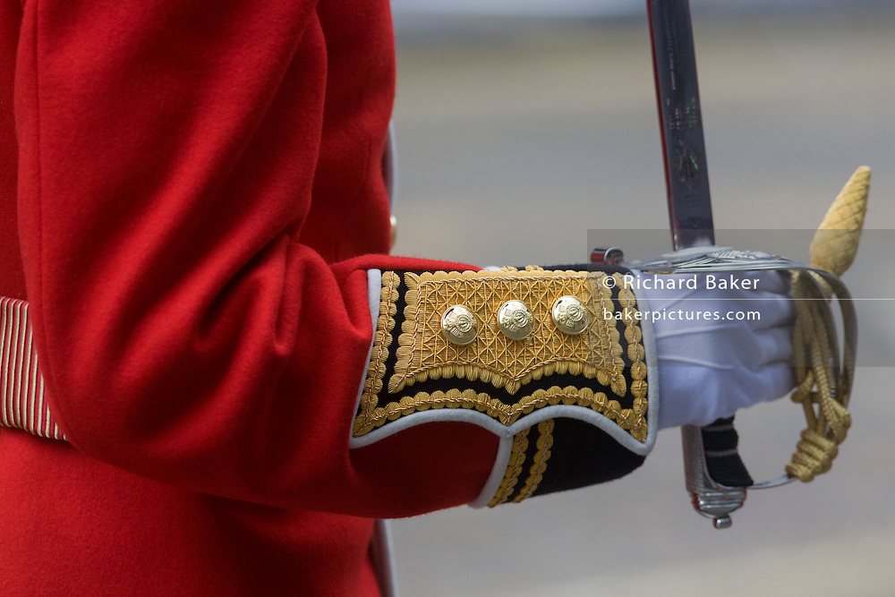 Detail of senior officers gloved hand before the funeral of Margaret Thatcher. Draped in the union flag and mounted on a gun carriage, the coffin of ex-British Prime Minister Baroness Margaret Thatcher's coffin travels along Fleet Street towards St Paul's Cathedral in London, England. Afforded a ceremonial funeral with military honours, not seen since the death of Winston Churchill in 1965, family and 2,000 VIP guests (incl Queen Elizabeth) await her cortege. Margaret Hilda Thatcher, Baroness Thatcher (1925 - 2013) was a British politician who was the Prime Minister of the United Kingdom from 1979 to 1990 and the Leader of the Conservative Party from 1975 to 1990, the longest-serving British Prime Minister of the 20th century and the only woman to have held the office to date.