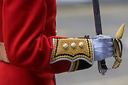 Detail of senior officers gloved hand before the funeral of Margaret Thatcher. Draped in the union flag and mounted on a gun carriage, the coffin of ex-British Prime Minister Baroness Margaret Thatcher's coffin travels along Fleet Street towards St Paul's Cathedral in London, England. Afforded a ceremonial funeral with military honours, not seen since the death of Winston Churchill in 1965, family and 2,000 VIP guests (incl Queen Elizabeth) await her cortege. Margaret Hilda Thatcher, Baroness Thatcher (1925- 2013) was a British politician who was thePrime Minister of the United Kingdomfrom 1979 to 1990 and theLeader of the Conservative Partyfrom 1975 to 1990, the longest-serving British Prime Minister of the 20th century and the only woman to have held the office to date.