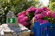 Number 3 outside a French house at St Germain Des Vaux in Normandy, France