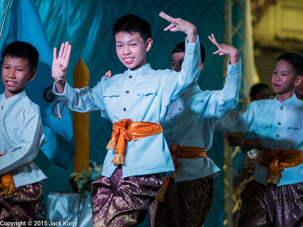 12 AUGUST 2015 - BANGKOK, THAILAND:   Thai students perform a historic pageant to honor Queen Sirikit of Thailand on her 83rd birthday. Queen Sirikit was born Mom Rajawongse Sirikit Kitiyakara on August 12, 1932. She is the queen consort of Bhumibol Adulyadej, King (Rama IX) of Thailand. She met Bhumibol in Paris, where her father was the Thai ambassador. They married in 1950, she was appointed Queen Regent in 1956. The King and Queen had one son and three daughters. She has not made any public appearances since her hospitalization in 2012. Her birthday is celebrated as Mother's Day in Thailand, schools and temples across Thailand hold ceremonies to honor the Queen and mothers.        PHOTO BY JACK KURTZ