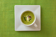 Fresh pea soup with ham hocks and creme fraiche, New York City.