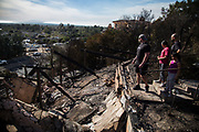 Family lives in Foothill Blvd in Ventura, California, sees their friend's house burned to thr ground after the wildfire occurred around that area. On Saturday, December 10th, 2017 at Foothill Blvd in Ventura, California. (Photo by Yuki Iwamura)