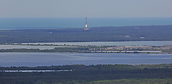 August 14, 2017 - Kennedy Space Center, FL, USA - The first stage of a SpaceX Falcon 9 rocket returns to Cape Canaveral on Monday, Aug. 14, 2017 after lifting off from launch pad 39A a few minutes earlier from the Kennedy Space Center carrying a  Dragon spacecraft that will deliver cargo to the International Space Station. (Credit Image: © Red Huber/TNS via ZUMA Wire)