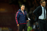 Louis van Gaal, the Manchester United Manager looks on from the touchline. The Emirates FA cup, 6th round replay match, West Ham Utd v Manchester Utd at the Boleyn Ground, Upton Park  in London on Wednesday 13th April 2016.<br /> pic by John Patrick Fletcher, Andrew Orchard sports photography.