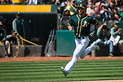 Oakland Athletics center fielder Dustin Fowler (11) scores a run against the San Francisco Giants at Oakland Coliseum in Oakland, California, on March 25, 2018. (Stan Olszewski/Special to S.F. Examiner)