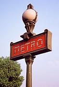 Close up photo of art nouveau metro sign at subway stop in Paris, France